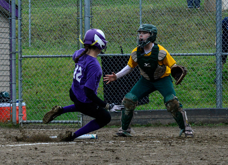 KRISTOPHER RADDER - BRATTLEBORO REFORMER<br /> Brattleboro's Hailey Derosia slides into home for the second run during a softball playoff game at Brattleboro Union High School on Tuesday, May 30, 2017.