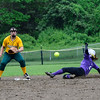 KRISTOPHER RADDER - BRATTLEBORO REFORMER<br /> Brattleboro's Devin Millerick slides into second before St. Albans' Elise Archambault during a softball playoff game at Brattleboro Union High School on Tuesday, May 30, 2017.