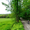 KRISTOPHER RADDER - BRATTLEBORO REFORMER<br /> Cyclists get a scenic view as they travel down Green River Road during the Tour de Heifer on Sunday, June 4, 2017.