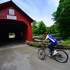 KRISTOPHER RADDER - BRATTLEBORO REFORMER<br /> Dean Gallea, of Tarrytown, N.Y., crosses the Green River using the Green River Covered Bridge during the Tour de Heifer on Sunday, June 4, 2017.