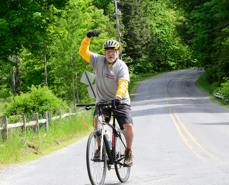 KRISTOPHER RADDER - BRATTLEBORO REFORMER<br /> Dave Bell, from Keene,  N.H., pumps his fist up into the air while traveling down Hinesburg Road during the 15 mile Tour de Heifer on Sunday, June 4, 2017.