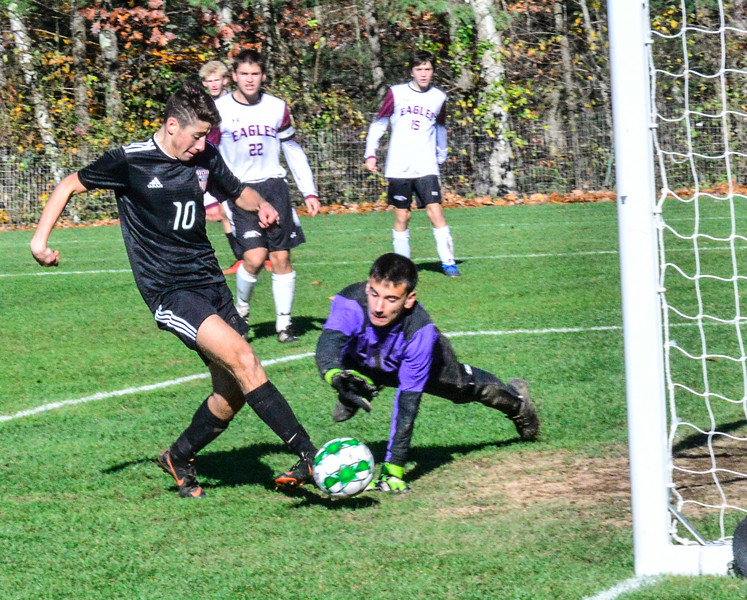 KRISTOPHER RADDER — BRATTLEBORO REFORMER<br /> Twin Valley's Lucas Messing nudges the ball in for the tie-breaking goal during the Vermont Principals' Association Boys' Division 4 Soccer Championship t