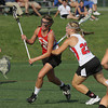 Upper Dublin's Kelly Cross takes a check to the ribs from Harriton's Hilary Lemonick.<br /> Bob Raines 5/24/11