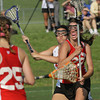 22ud 33hUpper Dublin's Kelly Cross fights her way toward the goal past Harriton's Alison Tepper.<br /> Bob Raines 5/24/11
