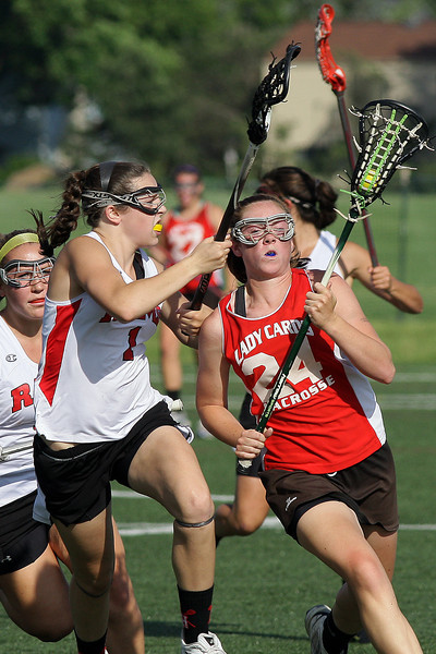 Upper Dublin's Brooke Callahan runs up the sidelines ubder pressure from Harriton's Katie Melvin.<br /> Bob Raines 5/24/11