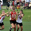 Upper Dublin's Kelly Cross harried by Harriton's Hilary Lemonick, left, and Megan Rubenstein.<br /> Bob Raines 5.24.11