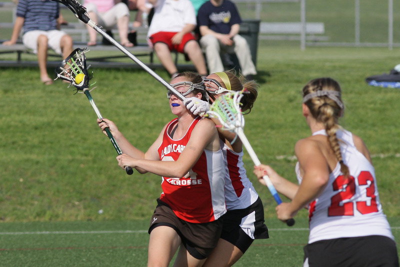 Upper Dublin's Brooke Callahan gets clubbed in the face by Harriton's Mackenzie Morgan as she tries to shoot.<br /> Bob Raines 5/24/11