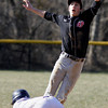 Upper Dublin shortstop Ray Sitarski leaps for the throw as Wissahickon's Matt Oruch steals second base.