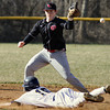 A bad throw gets past Upper Dublin's Cole Swiger as Wissahickon's Julian Osterneck steals second base.