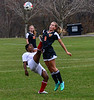Rhode Island  St. Andrew's School's Monica Neema kicks the ball away from Vermont Academy's Gwen Coger during the first round of the NEPSAC Class D playoff game at Vermont Academy on Wednesday, Nov. 16, 2016. Kristopher Radder / Reformer Staff