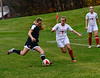 Vermont Academy's Chloe Aurard tries to keep the ball away from Rhode Island  St. Andrew's School's Emi Merritt during the first round of the NEPSAC Class D playoff game at Vermont Academy on Wednesday, Nov. 16, 2016. Kristopher Radder / Reformer Staff