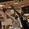 BB_WissCh_6686     Cheltenham's Nafis Walker lays up a shot past Wissahickon's Jordan Reed.
