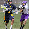 Wissahickon's John Carrozza drives for the crease past Upper Moreland's Matt Foley.