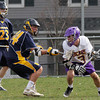 Upper Moreland's Chris Fleming looks for a way to the crease past Wissahickon's Jim Greene.