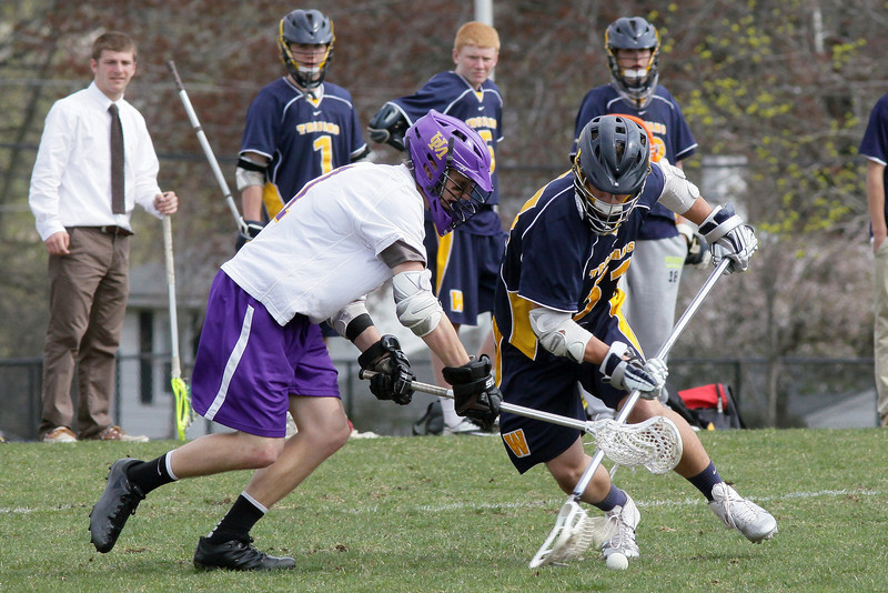 Upper Moreland's Joey Colbridge and Wissahickon's Chris Tronoski battle over a loose ball.