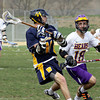 Wissahickon's Zach Scannapieco passes to the outside under pressure from Upper Moreland's Josh Barber.