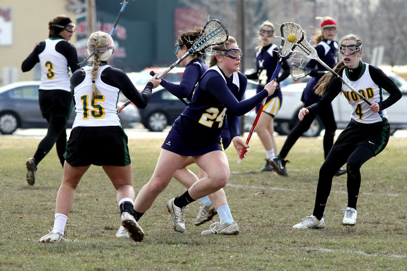 Wissahickon's Lauren Irvin dash between Archbishop Wood's Erica Sheehan, left, and Marah Hayes.