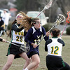 Wissahickon's Laura Frankenfield makes her way between Archbishop Wood's Megan Sears, left, and Elizabeth Buonomo.