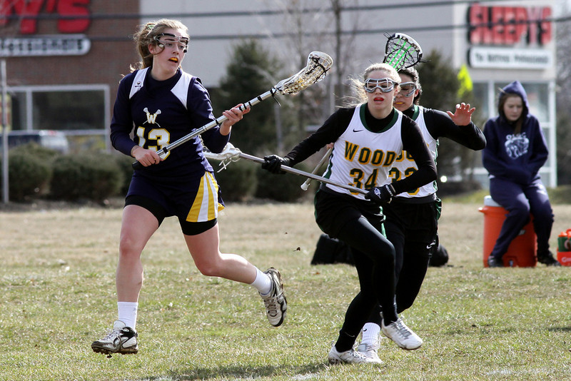 Wissahickon's Laura Frankenfield looks to pass after getting by Archbishop Wood's Austin Trasasatti.