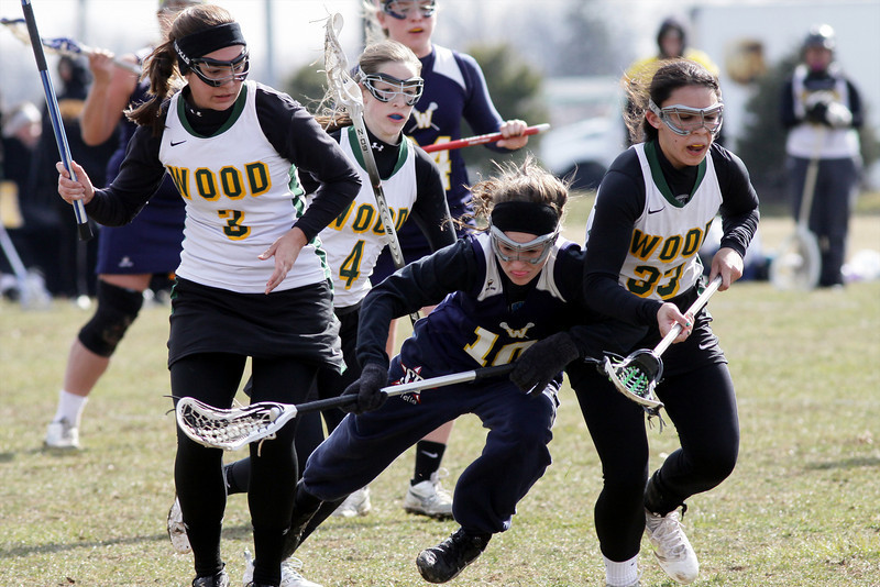 Archbishop Wood's Nicole Hutson, left, and Kiara Lynch batter Wissahickon's Jackie Hibbs in a fight for the ball.