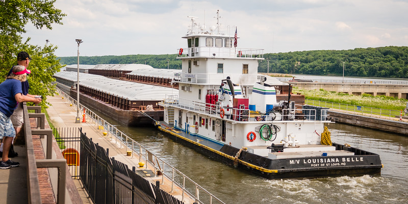 Across the Illinois River from the State Park, Starved Rock Lock and Dam shuttles tugs and barges  up and down the river.