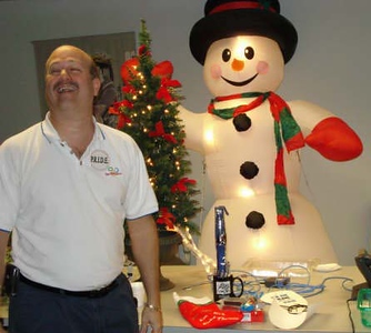 The smile and rosey cheeks will work, but if you are going to audition for Frosty's job - you have to open your eyes!
