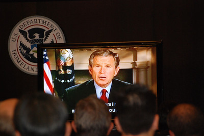President George W. Bush congratulates the new American citizens.