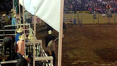 Bryan McElwee and Shane Esco bull fighting.