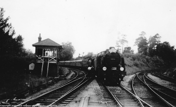 31803 (piloting 31411) East Grinsted High Level train arriving from Three Bridges'  The Wealdsman Rail Tour ' of  Sunday 13th June 1965...31803 leading 31411.
