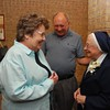 Ann and Mike Edmonds of Arlington greet Sister Rita Claire Davis. (Photo by Lance Murray / NTC)