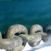 Strong chain on nautical background. Shallow depth of field.