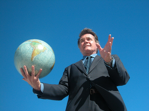 Businessman holding a globe.