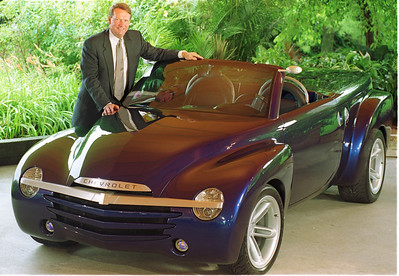 "General Motors President and CEO G. Richard Wagoner poses with the Chevrolet SSR at the Grand Traverse Resort in Traverse City, MI  prior to announcing that GM will build the the SSR. Customers will be able to ""buy this vehicle"" beginning 2002. The Chevrolet SSR was introduced at the 2000 Detroit Auto Show as a concept vehicle."