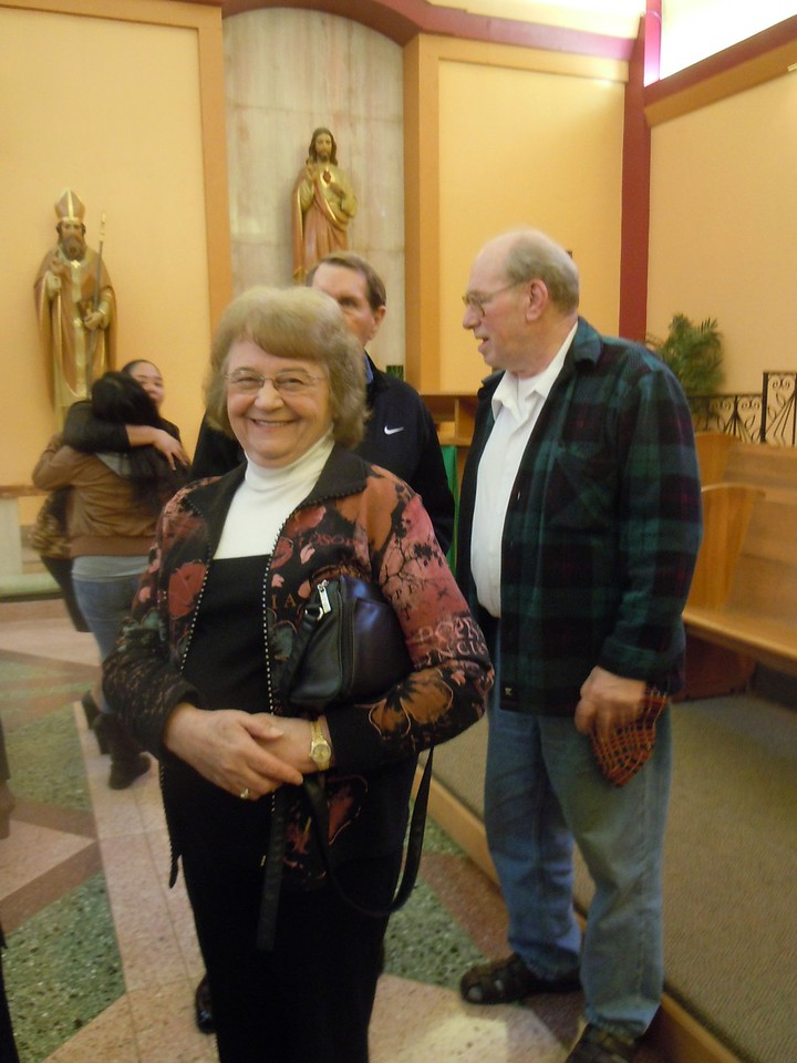 Paul plays at St. Anselm's Church with Don Bruhn and Don's daughter Denise who sang various songs during Sunday Mass on March 2, 2014.