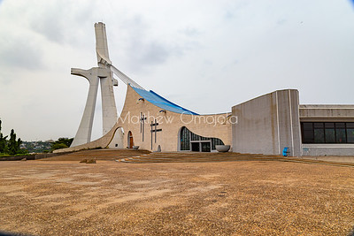 The rear view of St. Paul's Catholic Cathedral, Abidjan, Ivory Coast Cote d'Ivoire West Africa. The face on the left is a large crucifix that connects to the roof of the building by cables.