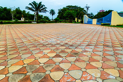 The front well tiled courtyard and gate and gardens of St. Paul's Catholic Cathedral, Abidjan, Ivory Coast Cote d'Ivoire West Africa.