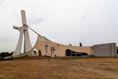The rear view of St. Paul's Catholic Cathedral, Abidjan, Ivory Coast Cote d'Ivoire West Africa. The face (on the left)  is a large crucifix that connects to the roof of the building by cables.