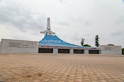 The front view of St. Paul's Catholic Cathedral, Abidjan, Ivory Coast Cote d'Ivoire West Africa. The face of the cathedral, the tall structure, is a large crucifix that connects to the roof of the building by cables.