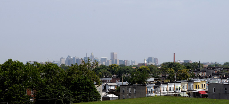 Downtown view over verdant residential neighborhoods from heights at Frederick Douglass High School