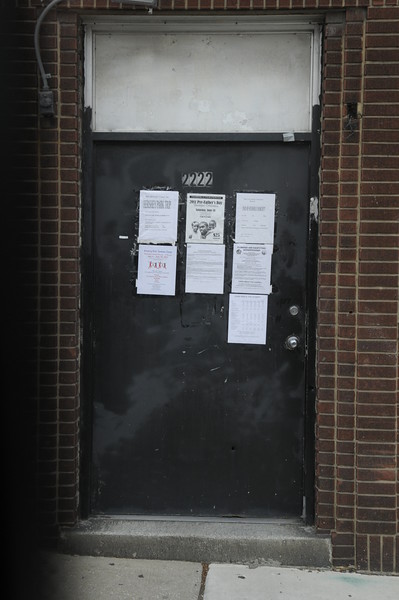 Community center door in East Baltimore with event announcements