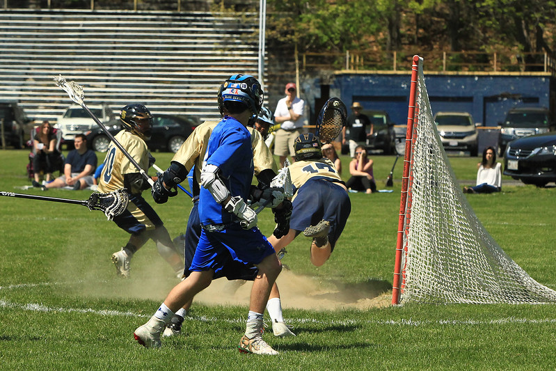 Scott LaPrade - StB's goalie Sean Kelly gets a jump on a save
