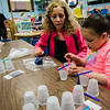 Preschool teacher Maria Sosa looks on as Adeliss Andino, 5, builds a bridge out of cups and popsicle sticks during the STEAM event at MOC Head Start Hosmer in Fitchburg on Wednesday, April 26, 2017. SENTINEL & ENTERPRISE / Ashley Green