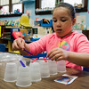 Adeliss Andino, 5, builds a bridge out of cups and popsicle sticks during the STEAM event at MOC Head Start Hosmer in Fitchburg on Wednesday, April 26, 2017. SENTINEL & ENTERPRISE / Ashley Green