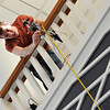 Eric Schwen '15 prepares to drop an egg from the third floor of the Science Building.