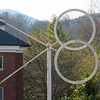 """The ever-moving sculpture """"Free Spirit,"""" by Drew Klotz, strikes a fleeting pose in the newly landscaped space between Graham-Lees and Gaines residence halls."""