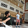 Conan Zhao '16 and Rob Jones '17 work with a drone in the Great Hall of the Science Center.