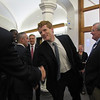 Congressman Joe Kennedy greets someone as he arrives at MassBay.