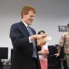 Congressman Kennedy enjoys a gadget made by MassBay's 3D printer.