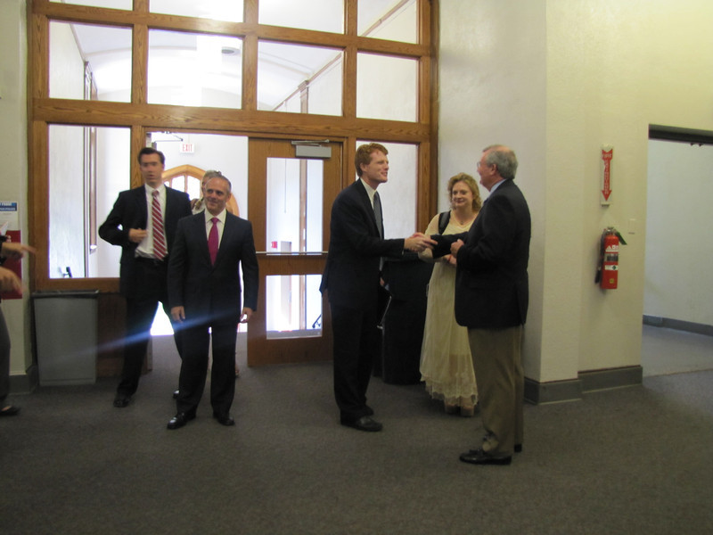 Congressman Kennedy greets MassBay President John O'Donnell as Education Secretary Matthew Malone arrives.