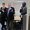 Congressman Kennedy and Newton Mayor Setti Warren listen in as President O'Donnell makes a comment during their tour of the STEM Division laboratories.